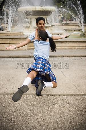 school children dancing salsa in center