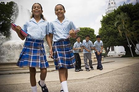 school children socializing in center plaza