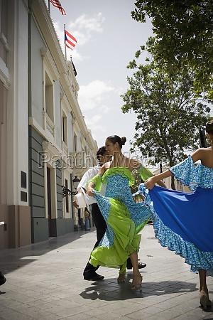children dancing plena traditional dance outdoors