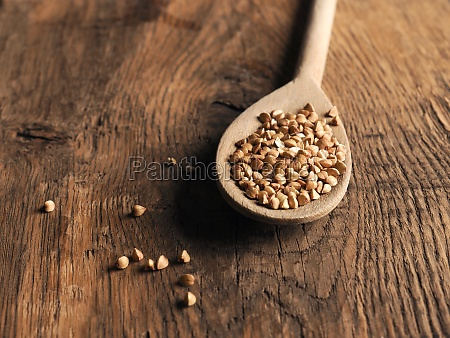 organic buckwheat on a wooden spoon