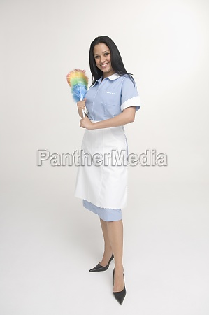 maid holding feather duster