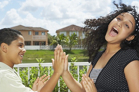teenage girl playing the clapping game