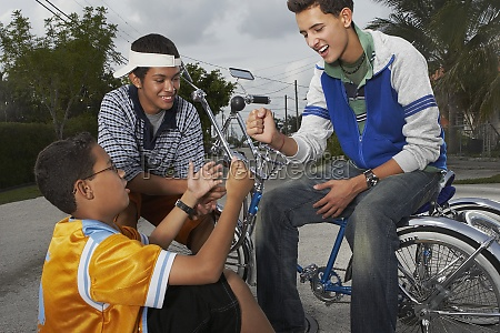 teenage boy gesturing to his two