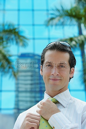 portrait of a businessman adjusting his
