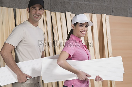 portrait of a couple holding sheets