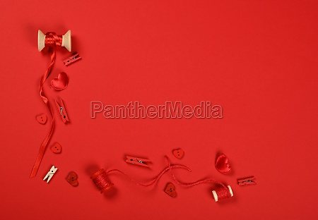 packing valentine gifts on red wrapping