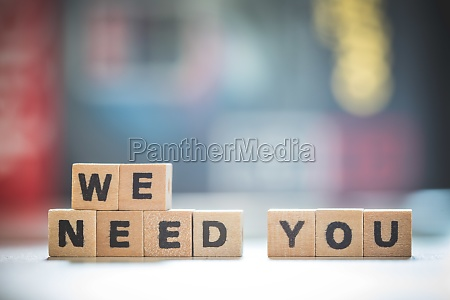 hiring and recruiting concept wooden we