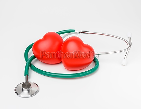 medical stethoscope and red rubber heart