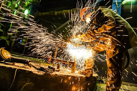 welder cooks a steel structure sparks