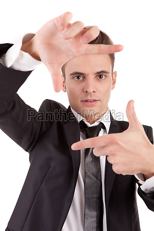 business man showing framing hand gesture