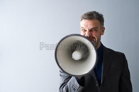 man making megaphone announcement