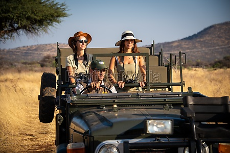 guide drives two female guests in