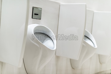 urinals with privacy walls in a