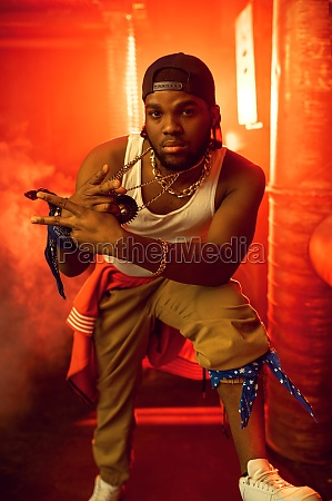 stylish rapper shows his gold jewelry