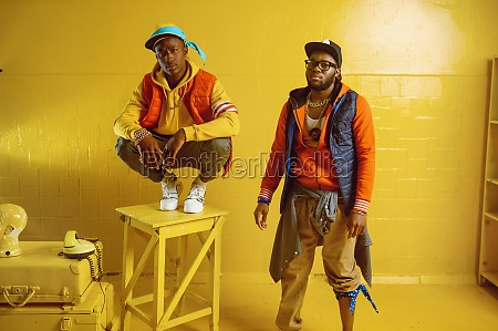 two stylish rappers in studio yellow