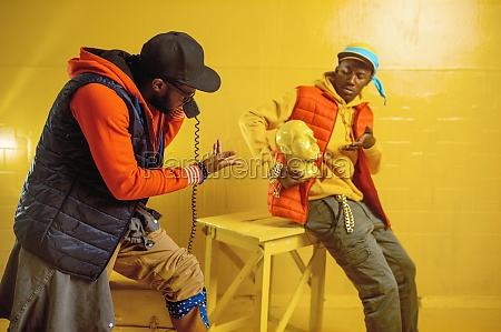 stylish rappers poses in studio yellow