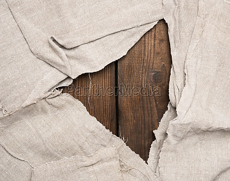 gray kitchen towel on brown wooden