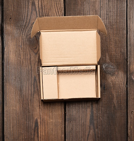 open brown cardboard paper box on