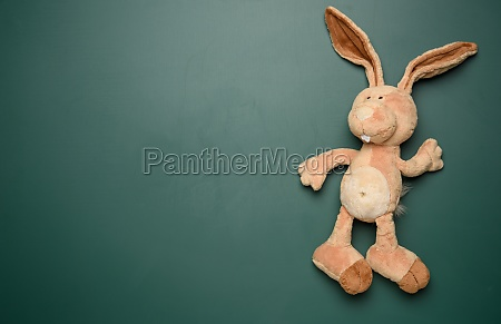 toy bunny on a green chalk