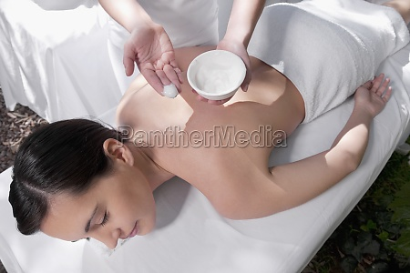 woman receiving back massage from a