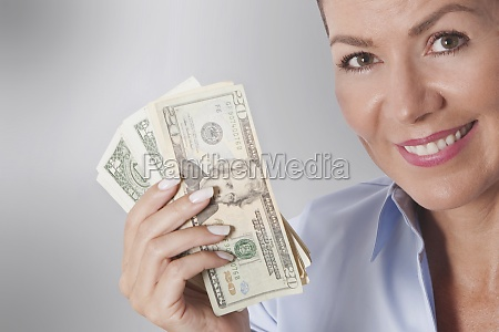 woman holding currency notes