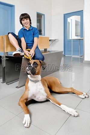 boy sitting with a dog in