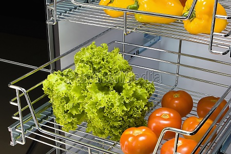 vegetables on shelves in the kitchen