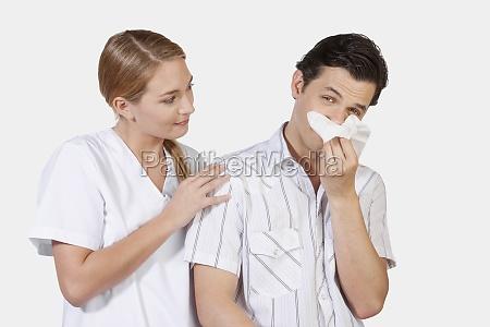 woman beside a man suffering from