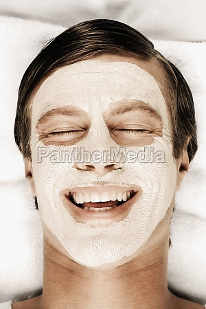 man with face pack on his