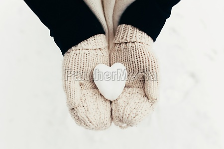 snow heart snowball in girl gloved
