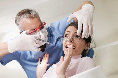 dentist injecting a patient