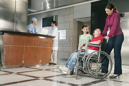 woman pushing her son in a