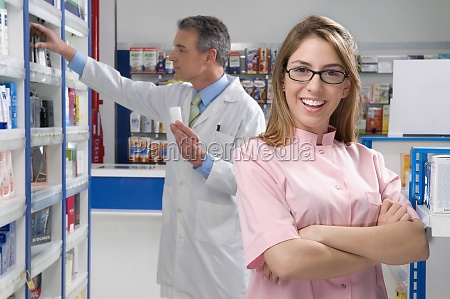 female pharmacist smiling with a male