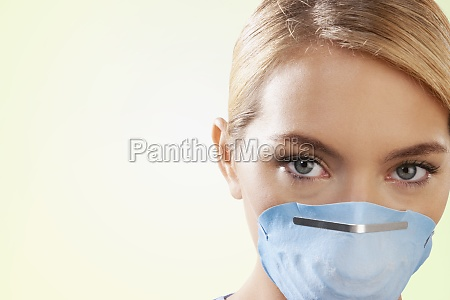 female nurse wearing a flu mask