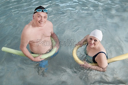 couple using pool floats in a