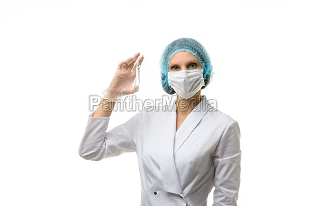 doctor holding ampoule with medical drug