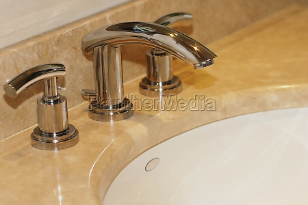 faucets on a bathroom sink
