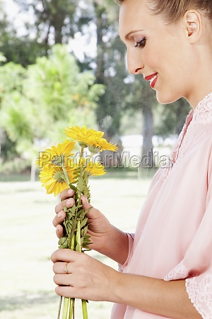 woman holding sunflowers