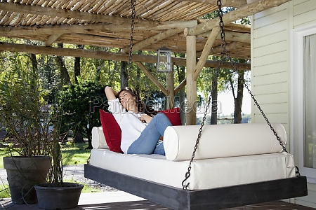woman napping on a porch swing