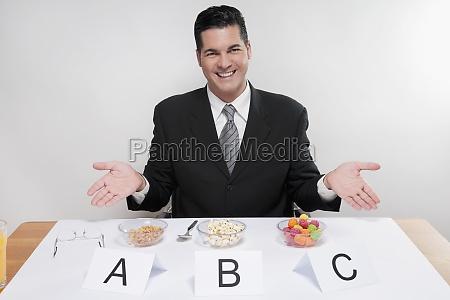 businessman showing food samples
