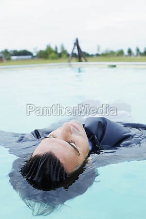 businessman swimming in a swimming pool