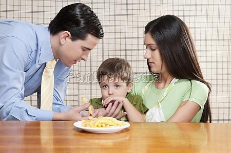 man feeding french fries to his