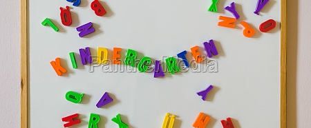 kindergarten concept colorful letters and the