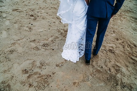 tbride and groom are walking on