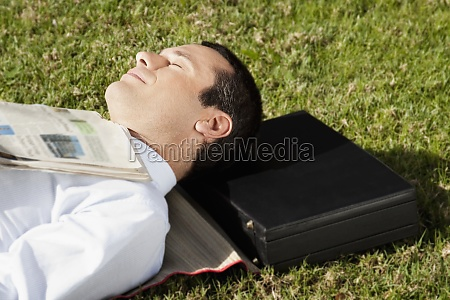 businessman napping in a park