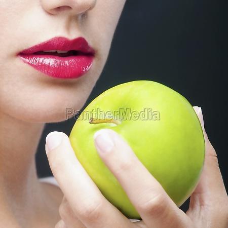 closeup of a woman holding a