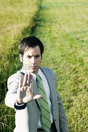 businessman showing stop gesture