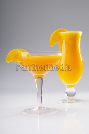 closeup of two glasses of orange