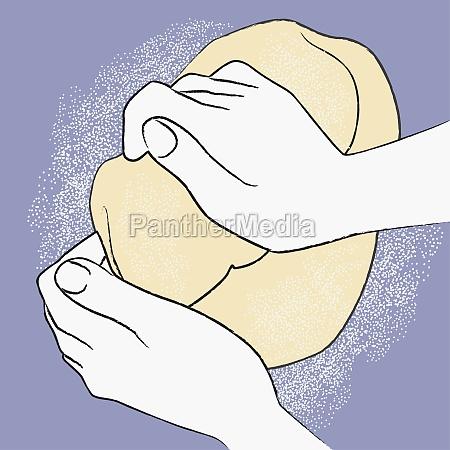 personZs hands kneading dough