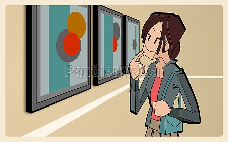 woman looking at paintings in an